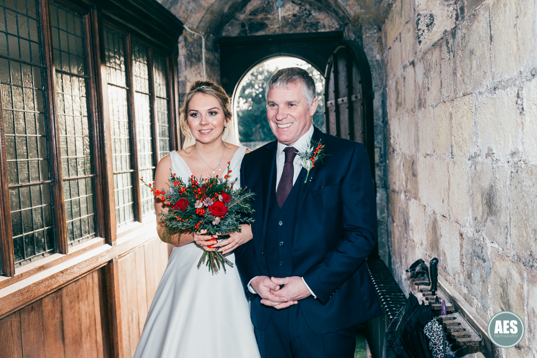 Bride and father in doorway at St Mary and Martins Church in Blyth