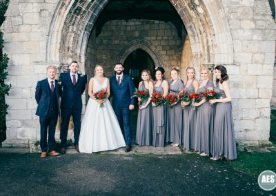 Bridal party in archway at St Mary and Martins Church in Blyth