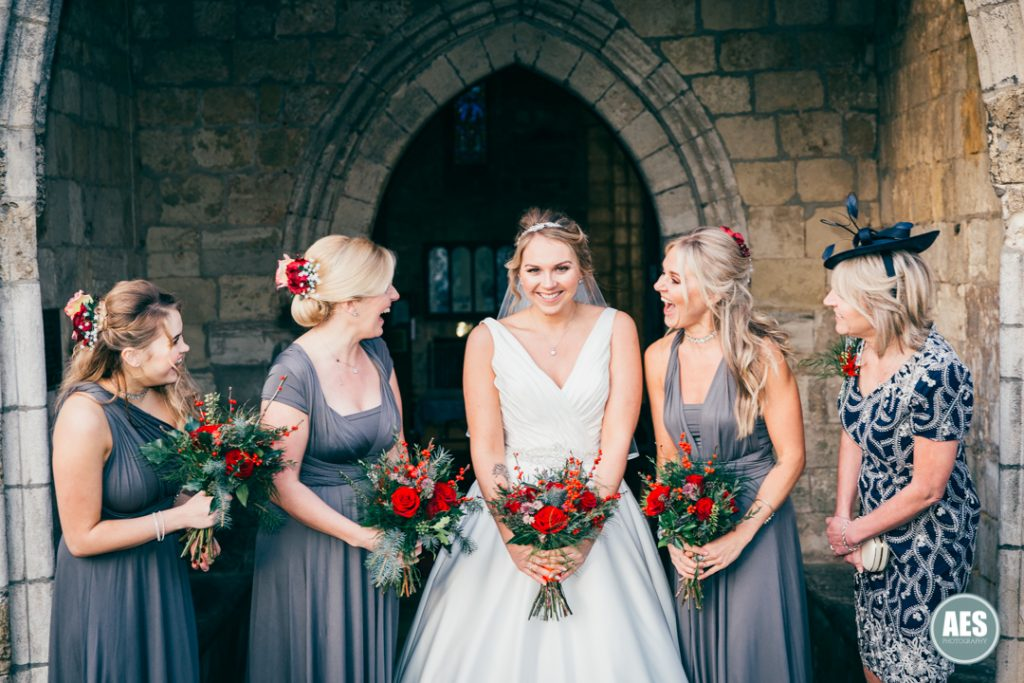 Bride and Bridesmaids outside St Mary and Martins Church in Blyth