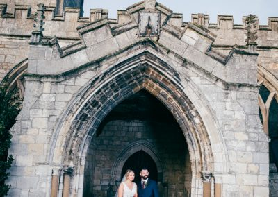 Bride and Groom in arch at St Mary and Martins Church in Blyth