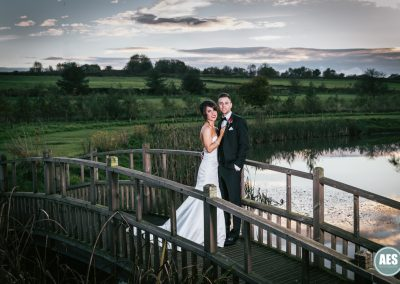 Bride and Groom on the bridge at Peal Edge Hotel