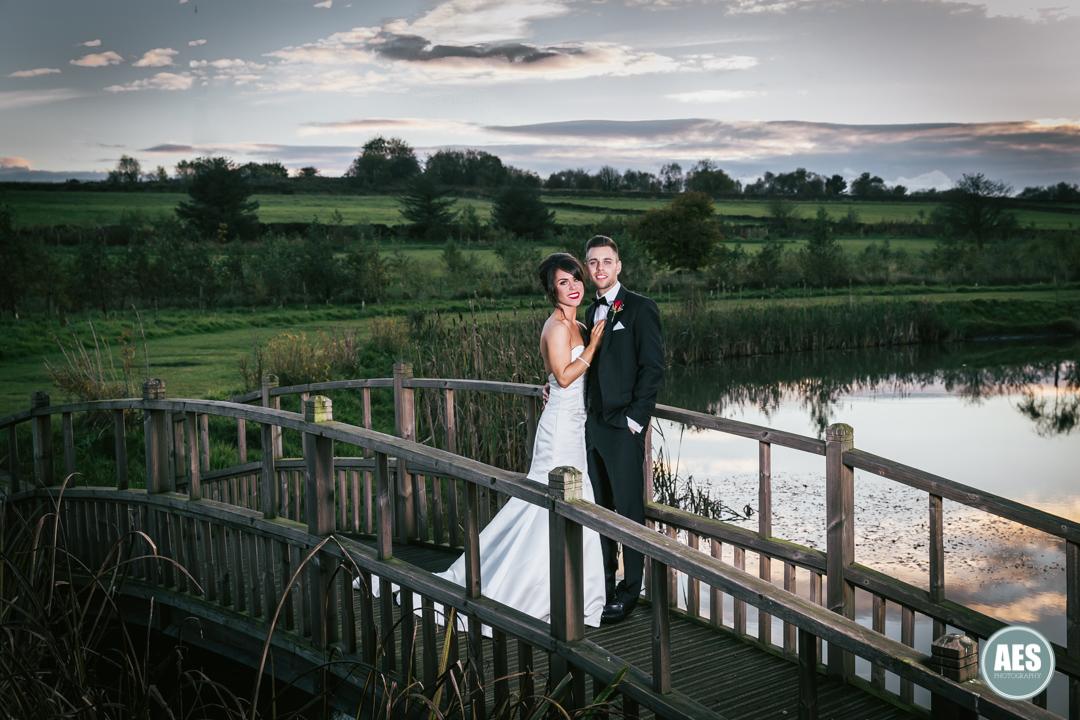 Bride and Groom on the bridge at Peal Edge Hotel