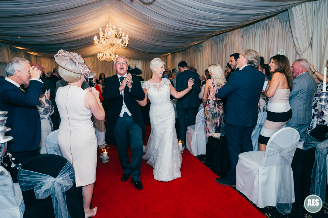 Bride and Groom dancing down isle at Hotel Van Dyk, Derbyshire