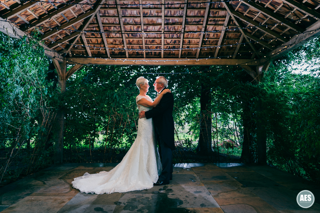 Bride and Groom under the pavilion at Hotel Van Dyk, Derbyshire