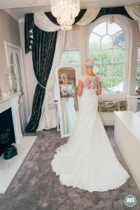 Bride in bridal suite mirror at Hotel Van Dyk, Derbyshire