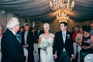 Bride walking down isle in Ballroom at Hotel Van Dyk, Derbyshire