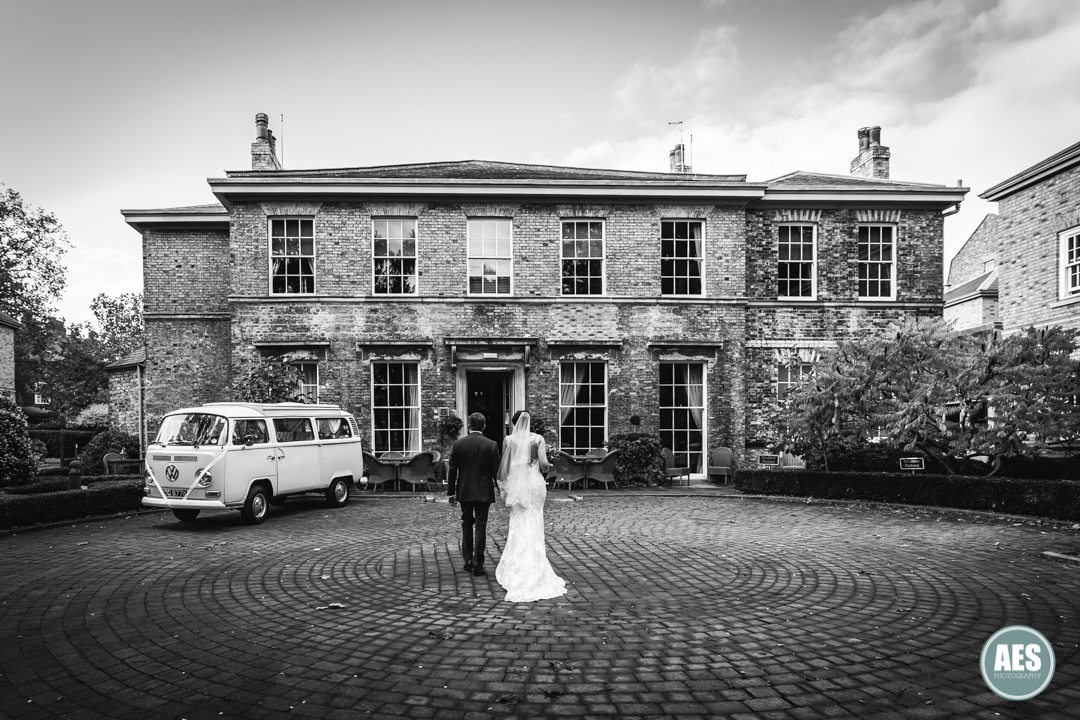 Bride and Groom walking into Hotel Du Vin in York