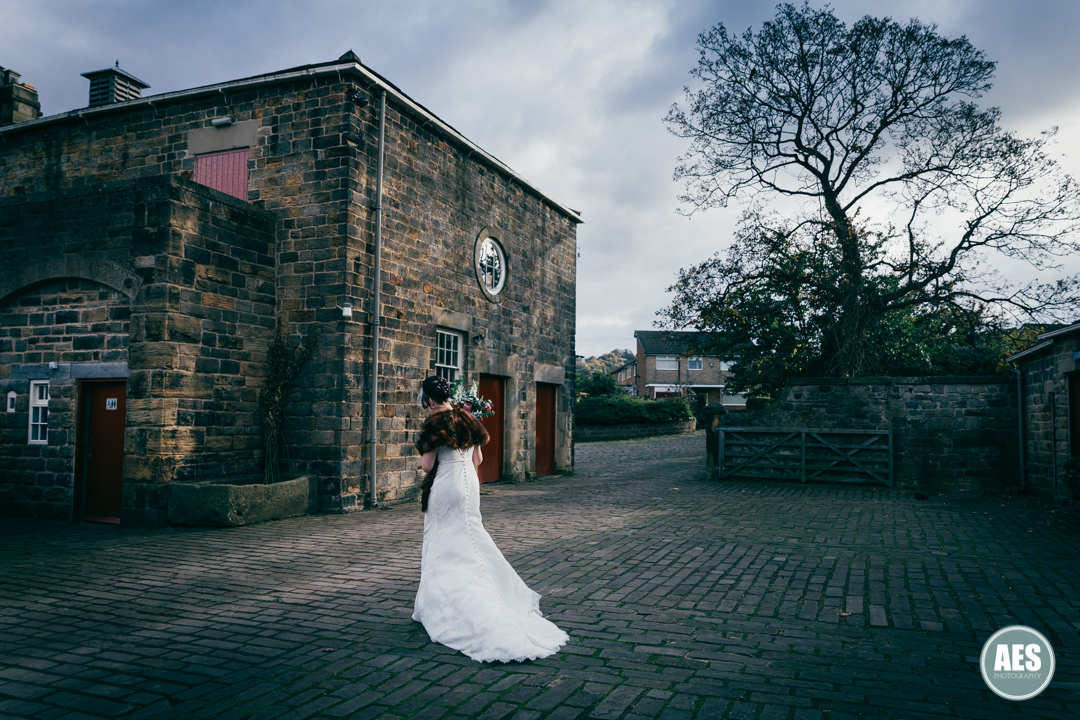 Bride walking during autumn wedding at Wood Lane Countryside Centre
