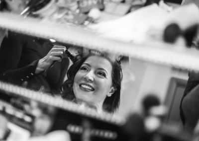 Bride in mirror at The Ashes Country House wedding venue