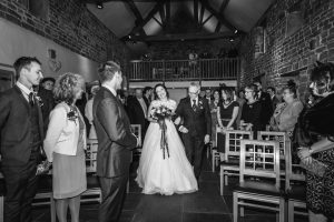 Walking down the aisle at The Ashes Country House wedding venue