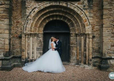 Bride and groom in church door at Eckington Church