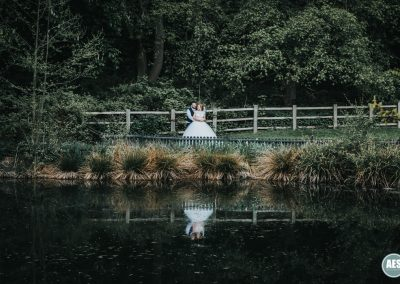 Bride and Groom lake reflection whitely hall hotel in Sheffield