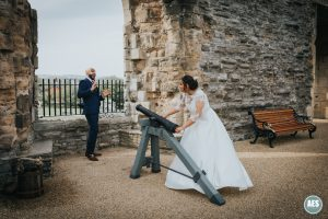 Bride firing cannon at Newark Castle in Nottinghamshire