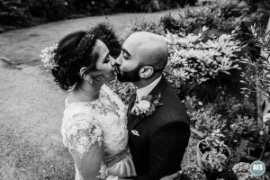 Bride and Groom kiss at The Ulvers in Nottingham