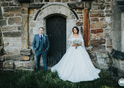 Bride and Groom in Church Doors at Laughton Church