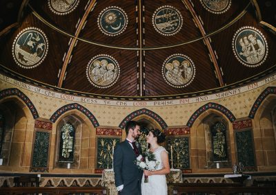 bride and groom under the ceiling at Emmanuel Church in Bestwood