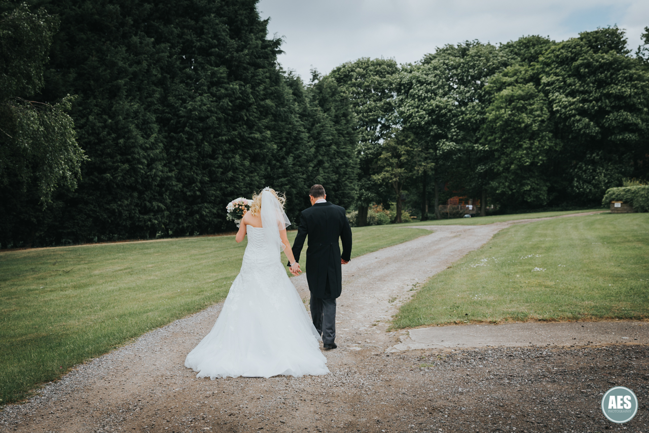 Bride and Groom walking photo at Red Brick House
